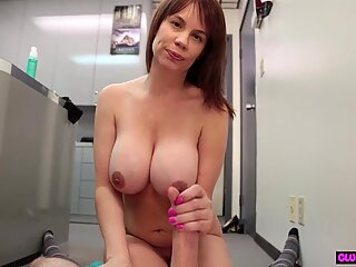 Busty milf strips down and strokes cock