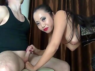 Hot German-Asia Slut plays with a Dick !!